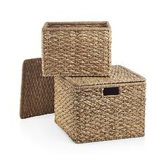 A thick and thin weave of natural rattan and bankuan fibers yields lots of texture to these handcrafted lidded baskets. Woven by skilled artisans around a square metal frame, each basket and flat-topped lid will keep its shape even when full or stacked. Inset handles add a clean look and allow for easy lifting.
