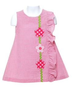 Seersucker Dress with Pink Appliquéd Flowers Simplicity amplified! Charming A-line seersucker dress in deep pink is embellished with a vertical row of appliquéd posies in complimentary polka dotted fabric Baby Frocks Designs, Kids Frocks Design, Frocks For Girls, Little Girl Dresses, Vestido Seersucker, Girls Frock Design, Kids Dress Wear, Baby Girl Dress Patterns, Toddler Dress