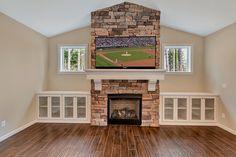Full Stoned fireplace surround, custom built mantle and built in bookshelves.
