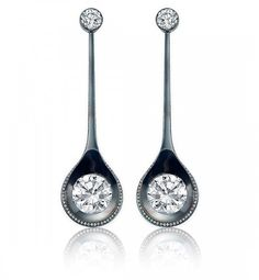 Spoon Earrings at Sotheby's Diamonds  Steel is a common but noble material. Each centering a round brilliant-cut diamond, weighing a total of 4.05 carats, with additional pavé set diamonds. Mounted in platinum and steel.