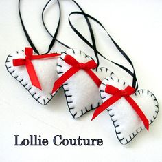 Inspiration...Valentine's Heart Ornaments Collection - Felt Hearts by Lollie Couture...$25.00    10 pretty little felted hearts that pop with personality!    Use them for decorations, gift tag accents, Valentines Day gifts and so much more!    Hand embroidered with satin hanging string and bow.