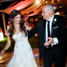 """The bride and her dad danced to """"The Way You Look Tonight"""" by Frank Sinatra for their father/daughter dance."""