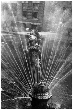 """""""Ultimately photography is about who you are. It's the seeking of truth in relation to yourself"""": Leonard Freed. Photo taken in Harlem, New York City, 1963 when the fire hydrants are opened during the summer heat (© Leonard Freed / Magnum Photos USA)"""