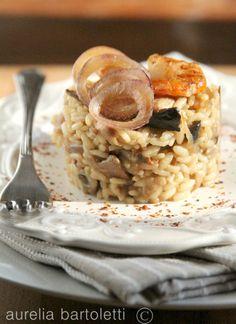Risotto al Parmigiano Reggiano, cipolla caramellata, e gamberi/Risotto with Parmesan cheese, caramelized onions, and shrimp