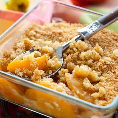 Delicious peach crumble served warm with ice cream