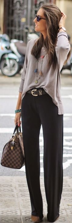 Classic lines, sweater, flared pants, belt, bag, jewelry.