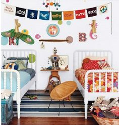love the vintage feel of this room - white wood framed beds and the vintage patterned letters, owl pillows