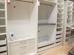 """IKEA Pax- for the wardrobe wall, then """"rich it up"""" with some custom full length raised panel doors and moulding."""