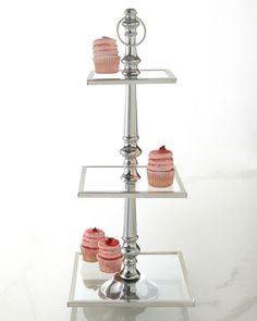 "This is very cool, very modern.  3 Tiered Tray in Glass & Polished Aluminum.  STands 17-3/4"" tall.  Largest plate is 16"" square.  $325 from Horchow.com"
