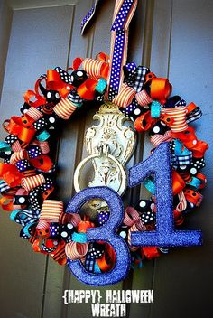 i don't do halloween but this is a good tutorial for a ribbon wreath. gonna be on the look-out for some cheap ribbon so i can make one of these!