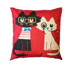 his sophisticated cat duo go by Wellington and Kenneth. They would not be caught dead without their glasses, bow-ties, monocles - bringing a level of sophistication to any room. This bright red pillow is a cozy and colourful addition to a living room or bedroom.