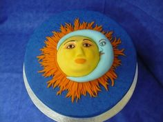Sun & Moon - Sun and moon are made from fondant and placed on a 12in round cake iced in blue then sponge painted with blue airbrush color.