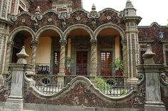 Rococo-style stone house. Rococo-style architecture in stone and brick behind iron fence, Guadalajara, Jalisco, Mexico