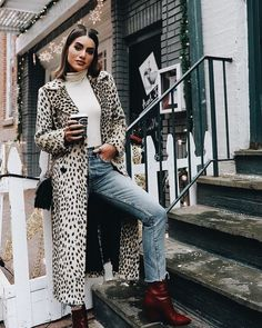 Chic animal print maxi coat over denim jeans and white sweater.
