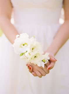 For bridesmaids- I like how this wrist piece is substantial- covering part of the hand as well, and using large white flowers.