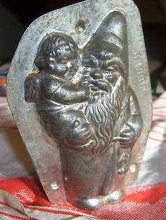 Antique Anton Reiche Chocolate Mold of Santa with Cherub, ebay| $1,236