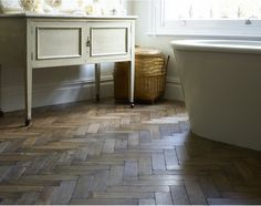 Broadleaf Worn Vintage Oak Parquet Flooring - a versatile, inviting reclaimed style parquet floor in tones of bronze grey. Vintage in style, modern in feel and available as blocks or chevrons. Adds a modern edge to period interiors and instant character to more contemporary ones.