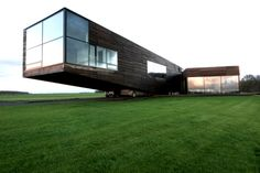 This has to be one of the most unique-looking houses I've ever seen. The private residence, located in the town of Utriai, Lithuania, was designed by architecture firm G.Natkevicius and Partners. Check out where they park their cars. A little sketchy to say the least...…