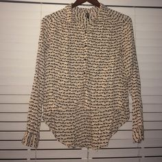 Animal printed button up Tan button up with black printed deer,foxes & mouse. Super cute & comfortable worn twice Tops Button Down Shirts