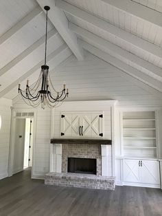 Plan Country Craftsman with Vaulted Interior and French Door Foyer White shiplap Vaulted Ceiling, black chandelier, old Chicago Brick on fireplace Shiplap Ceiling, Ceiling Beams, Vaulted Ceilings, Living Room Vaulted Ceiling, Ceiling Color, Ceiling Panels, Ceiling Design, Farmhouse Fireplace, Brick Fireplace
