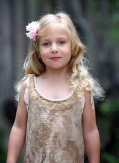 Beige fancy feted dress for a little girl with a silk by GBDesign
