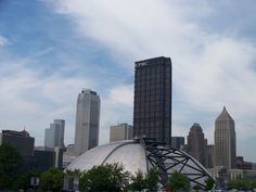 old Mellon Arena behind skyline of Pittsburgh