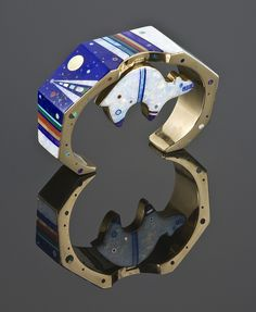 14k gold bear bracelet inlayed with Australian opal, lapis, coral, turquoise, and sugilite by Jesse Monongye
