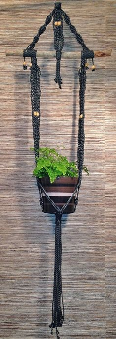Unique Macrame Plant Hanger would be fabulous on my patio this summer. Love the vintage feel.