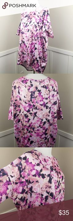 LuLaRoe Dressy Irma Floral Purple Pink NWT sz L NWT Irma in a dressy fabric - not the typical cotton blend LLR. Excellent choice for church, wedding, career, and casual wear. If you have never worn Lularoe you size down 1-2 sizes from your normal shirt size for an Irma. Example: I normally wear a Medium shirt but wear an XS or a S in an Irma. From a smoke-free home. LuLaRoe Tops Tees - Short Sleeve