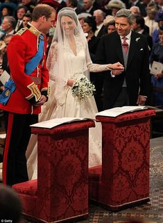 'You look beautiful': Prince William speaks to his bride Kate as she holds her father's hand at the altar.