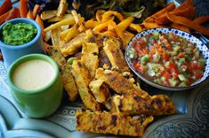 Crispy polenta sticks with sour-roasted oven vegetables and three dip - pea mint, kiwi tomato and orange tahini Tahini, Crispy Polenta, Oven Vegetables, Snacks Für Party, Main Meals, Chicken Wings, Dips, Roast, Vegan Recipes