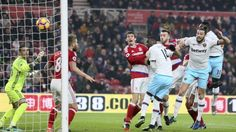 West Ham United's Andy Carroll, second right, scores his side's first goal of the game during their English Premier League soccer match against Middlesborough at the Riverside Stadium, Middlesbrough, England, Saturday, Jan. 21, 2017. (Richard Sellers/PA via AP)