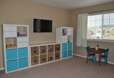 Playroom storage using #Expedit shelving and baskets from #Ikea.