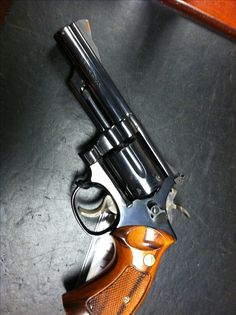 Smith and Wesson model 19 .357 Check!....everyone should have one and this one does just nicely.