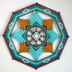 Jay Mohler - http://www.etsy.com/listing/77852143/southwest-classic-ojo-de-dios-24-inches