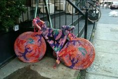 A friend of mine was walking down the street in Soho NYC today and spotted this bike. We've heard of some very creative yarn bombing, but this one takes the cake! Someone pointed out that it looks like the work of Agata Olek, and