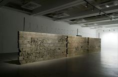Teresa Margolles, a Mexican installation artist, uses her work to address the violence of Mexico's drug war. In the above installation, a wall with bullet holes shows the extent of the violence. In another work, she had the floors of an exhibition space mopped with the water used to wash corpses in the morgue.