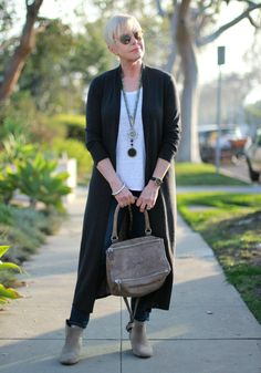 Layered necklaces give this simple outfit of soft neutrals a boost.