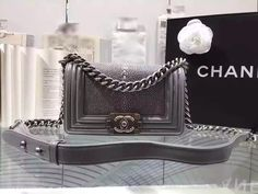 CHANEL Exotic Pearl Fish Grey Small Boy Bag for sale at https://www.ccbellavita.eu/products/chanel-exotic-pearl-fish-yellow-small-boy-bag