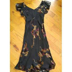 Beautiful black gown Beautiful black gown with sheer short sleeves and velvet flower detailing. Very classy and pretty. It is a size ten but runs a little small. It fits like a size 8/Medium Jones New York Dresses