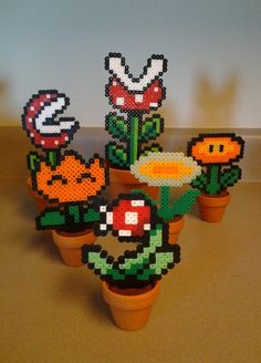 Finally finished the first batch of perler bead sprite plants. They're so fun to make, and the NES Mario Bros fireflower (middle right) glows in the dark! Now for sale here!: www.etsy.com/listing/2...