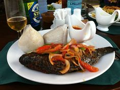 Ghanaian style cooked Banku and Ghanaian style Grilled Tilapia
