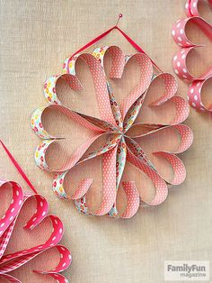 Pretty paper and glue dots are all you need to make a heartwarming wreath to hang anywhere that needs a little love. Cut a sheet of double-sided scrapbook paper (ours is a 12-inch square) into 1-inch-wide strips. Make five hearts as follows: Fold a paper strip in half, sandwiching two glue dots about an inch down from the fold to create the top of the heart. Bend the loose ends away from the center and use two more dots to join them at the point. Next, make the two hearts that anchor the…