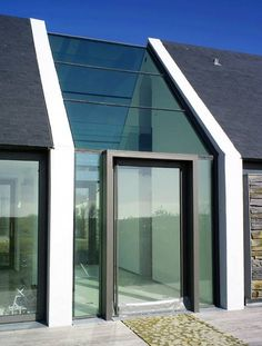 New take on the traditional ...Belle Iloise House, Britanny by Paris studio Opus 5 Architects.  A glazed walkway connects the bedrooms to the rest of the house.