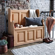 Dorchester Pine Small Bench from The Cotswold Company   Free Delivery and Returns    Small pine monks bench with storage styled in a country house with distressed brick wall and grey wool rug.