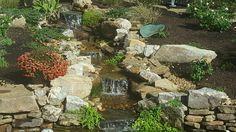 A beautiful stream flows into the water garden below.