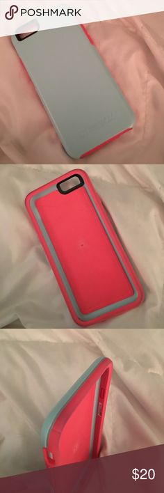 Otterbox Symmetry iPhone 6/6s Case I am selling all of my old cases as I am getting a new phone. This is the otterbox symmetry in boardwalk. It is pink and blue and in a good condition. There is a little big of pen ink that is hard to remove on the top of the case shown in picture 3. Accessories Phone Cases