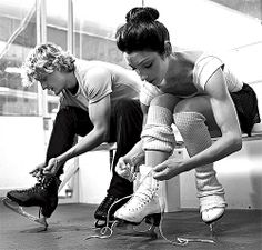 Meryl  Charlie lacing up their skates (look at those arms!)