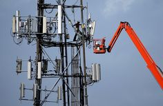 A worker climbs on a cellular communication tower in Oakland, California on March 6. (Justin Sullivan/Getty Images)
