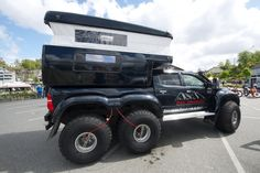 Toyota Hi-Lux Arctic Trucks AT44 6x6 conversion with a slide-in pop-up camper for colder climate, owned by Dreki Adventures, Iceland and Norway, made by Arctic Trucks.